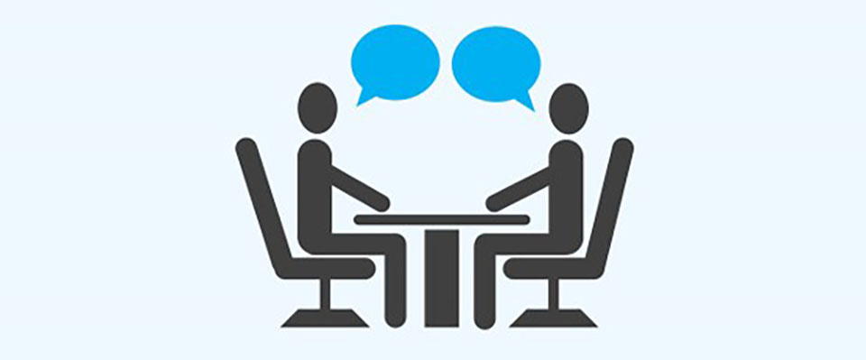 Graphic of two people talking to each other at a desk