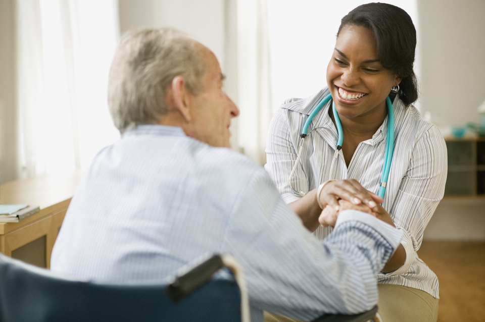 Nurse and elderly man spending time together